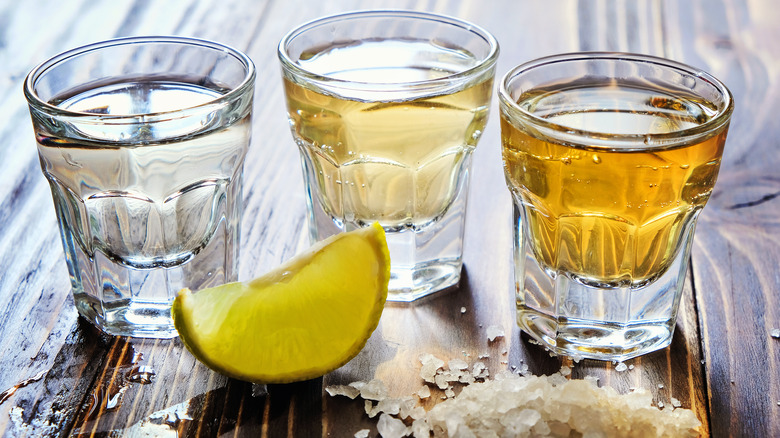Shots of tequila with salt and lime