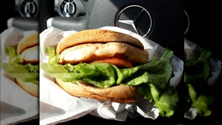 Whataburger Grilled Chicken Sandwich in a car