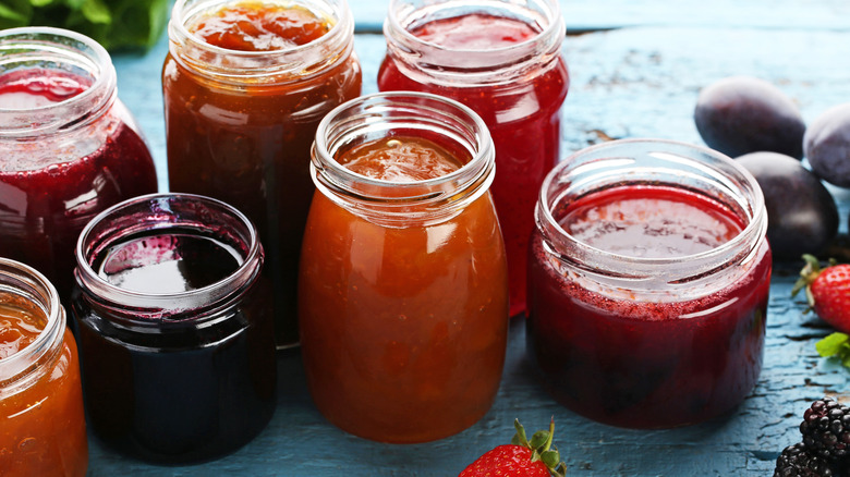 Jars of different colors of jams