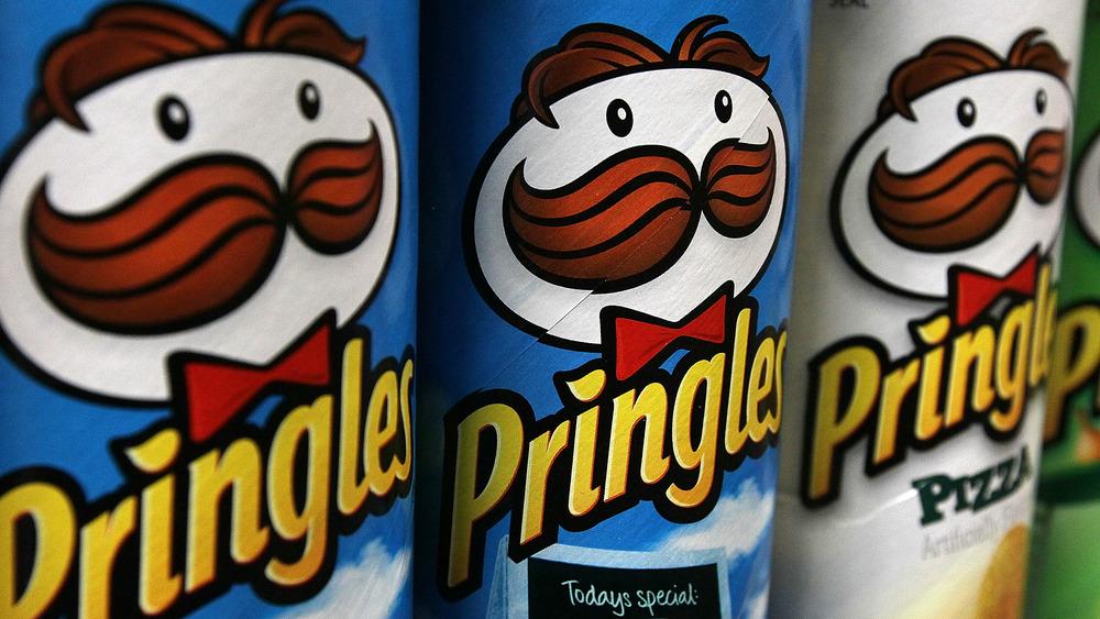 Three Pringles cans