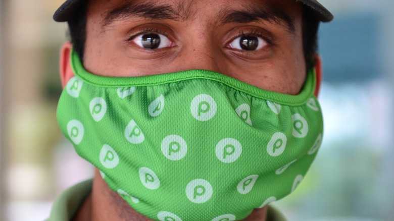 Publix employee in branded mask