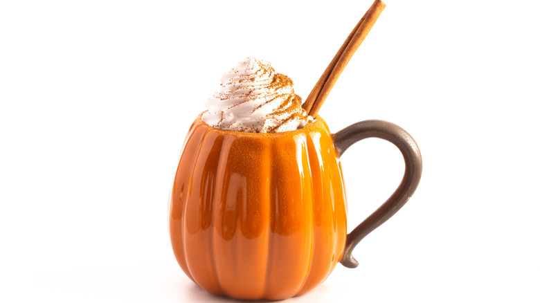 Pumpkin spice latte in pumpkin shaped mug