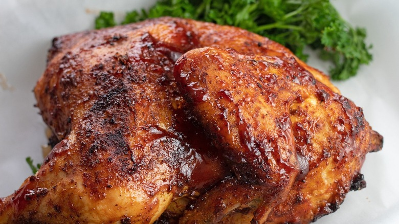 BBQ half chicken on plate with parsley