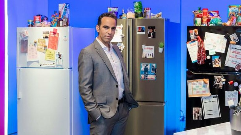 Dan Ahdoot next to refrigerators