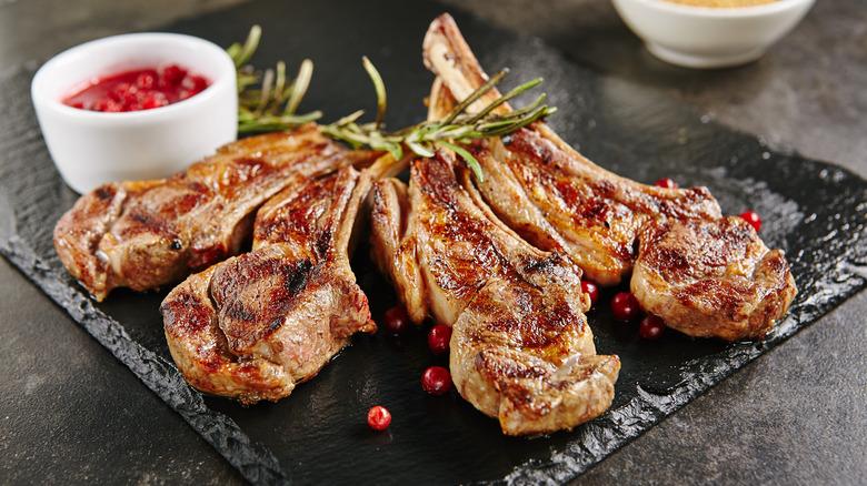 Grilled lamb chops on a black dish