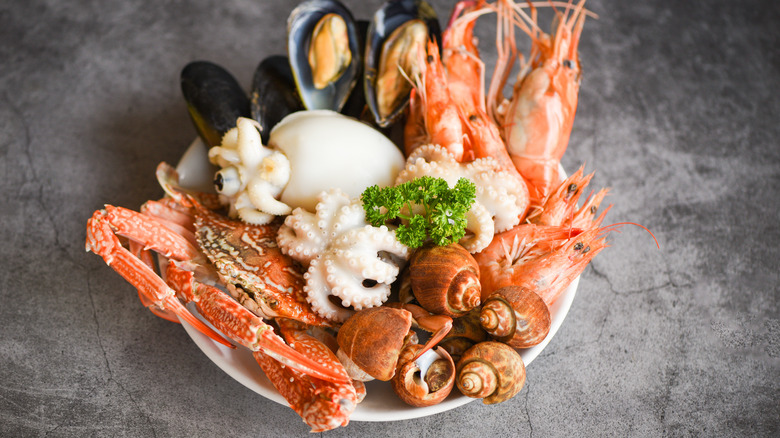 Plate of crab legs and clams on counter