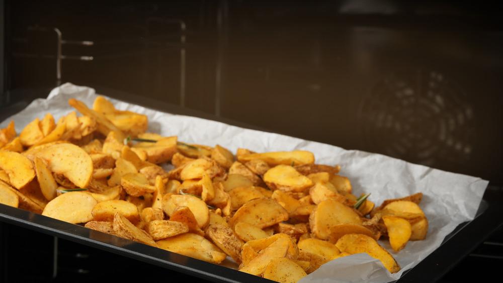 potato wedges on parchment paper