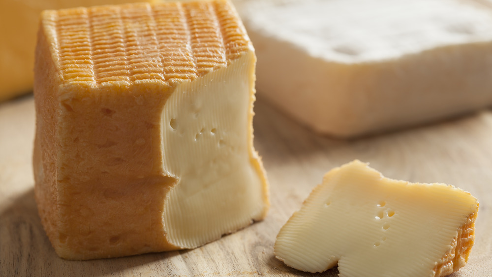 Chunk of limburger cheese with piece cut out