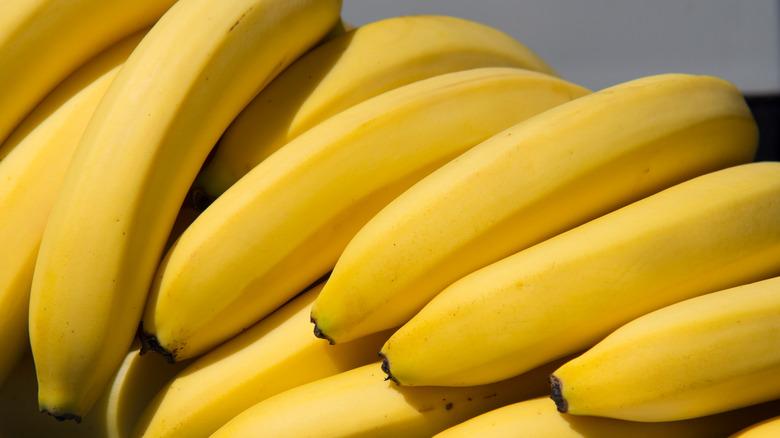 Pile of whole yellow bananas