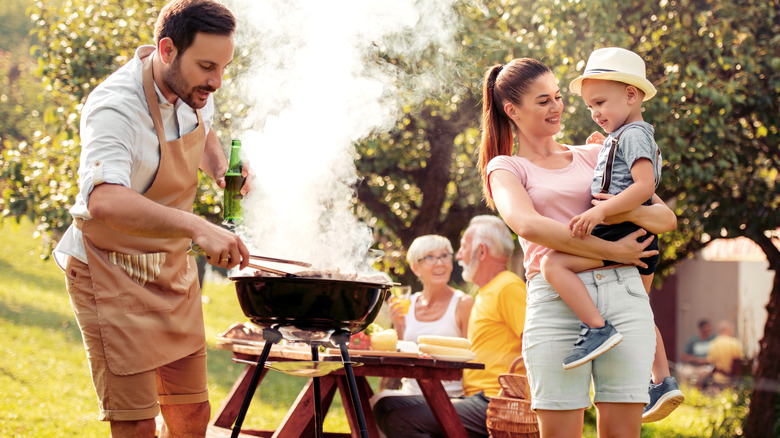 Family using public grill