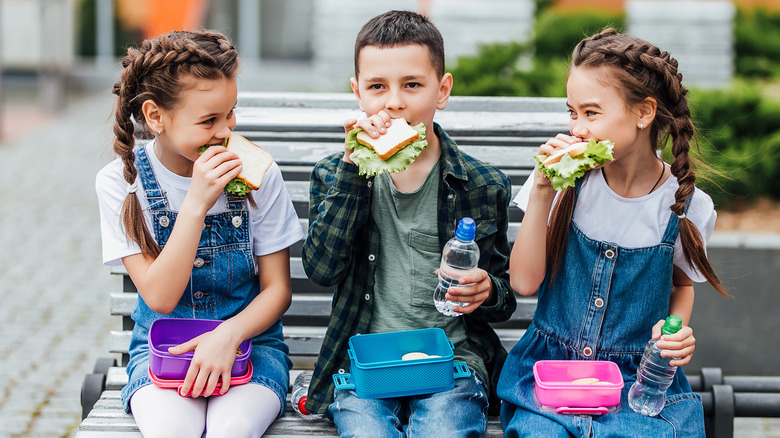 kids eating lunch school lunch boxes