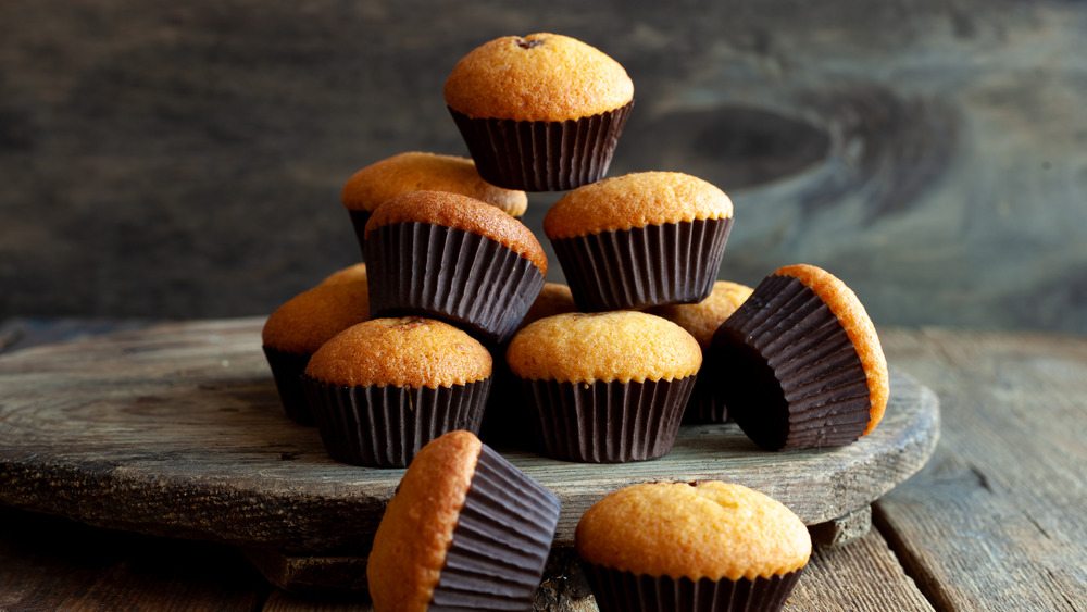 Pile of muffins on a wooden board