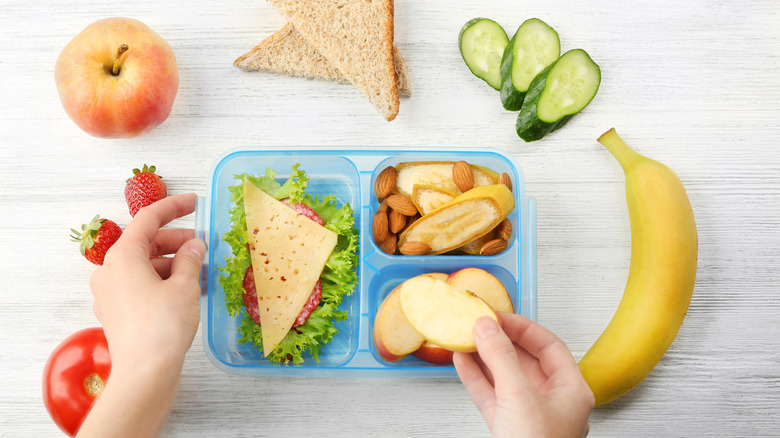 Food in and around a lunchbox
