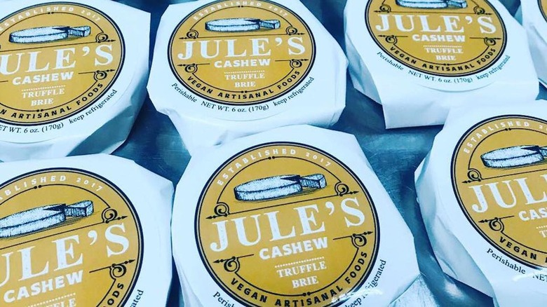 Rows of Jule's Foods Cashew Truffle Brie cheeses