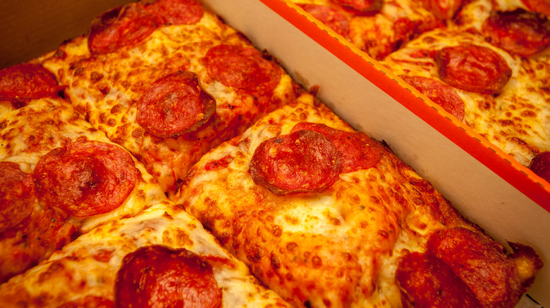 Square sliced deep dish pepperoni pizza