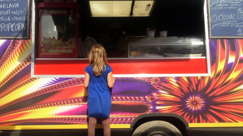 Girl ordering from food truck