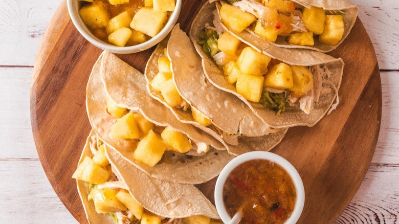Costco tacos on a plate with pineapple
