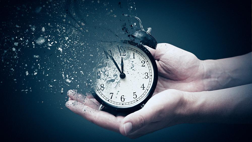 Hands holding clock