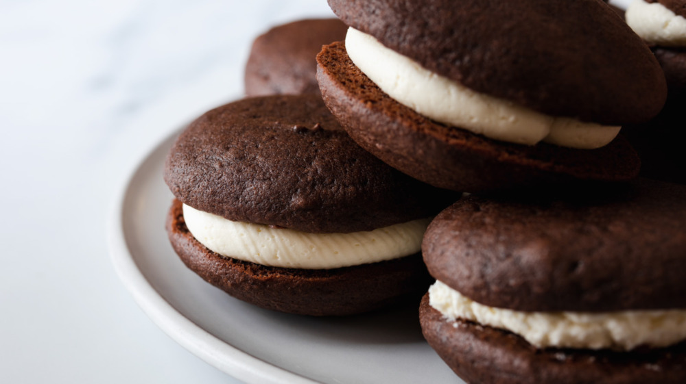 Close up of a whoopie pie chocolate cookie with white frosting filling
