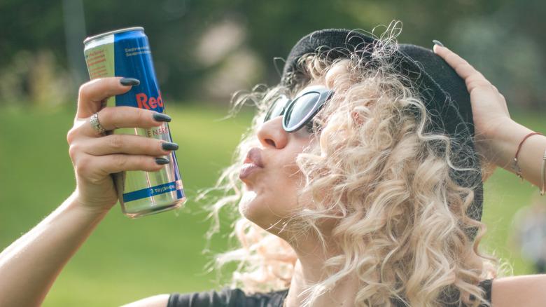 Woman blowing kiss at Red Bull
