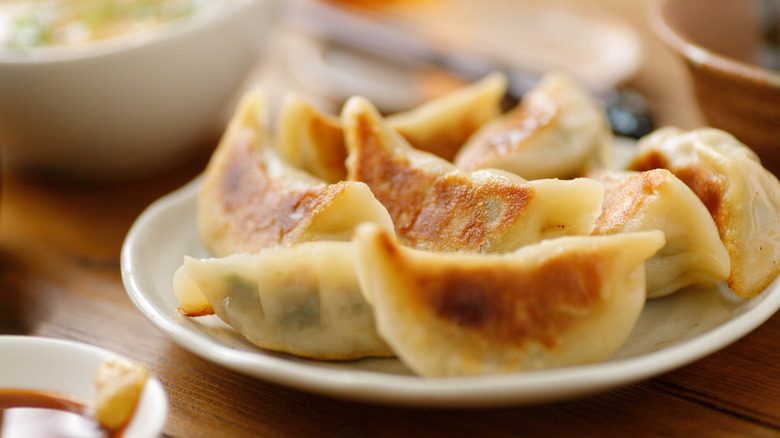 plate of pan-fried potstickers