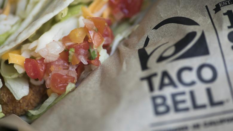 Taco alongside Taco Bell logo on wrapper