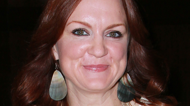 Ree Drummond poses before a sign