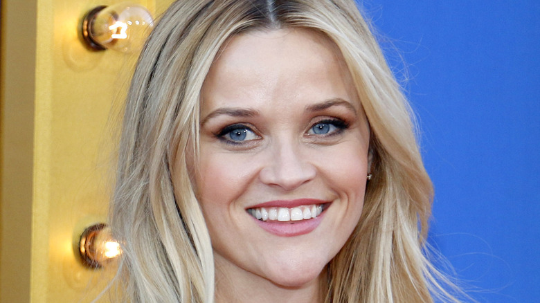 Reese Witherspoon smiling at event