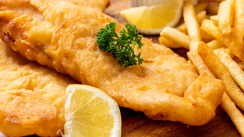 fish and chips on wooden platter
