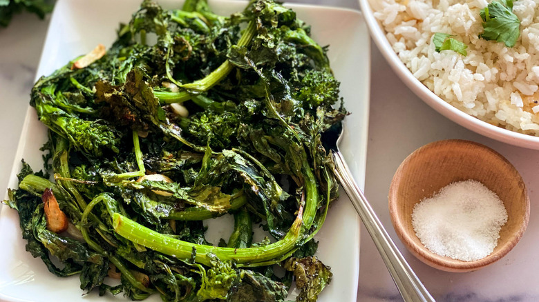 roasted broccoli rabe on plate with fork