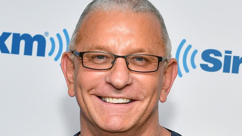 Robert Irvine smiling in glasses