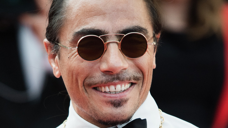 Salt Bae smiles while attending event