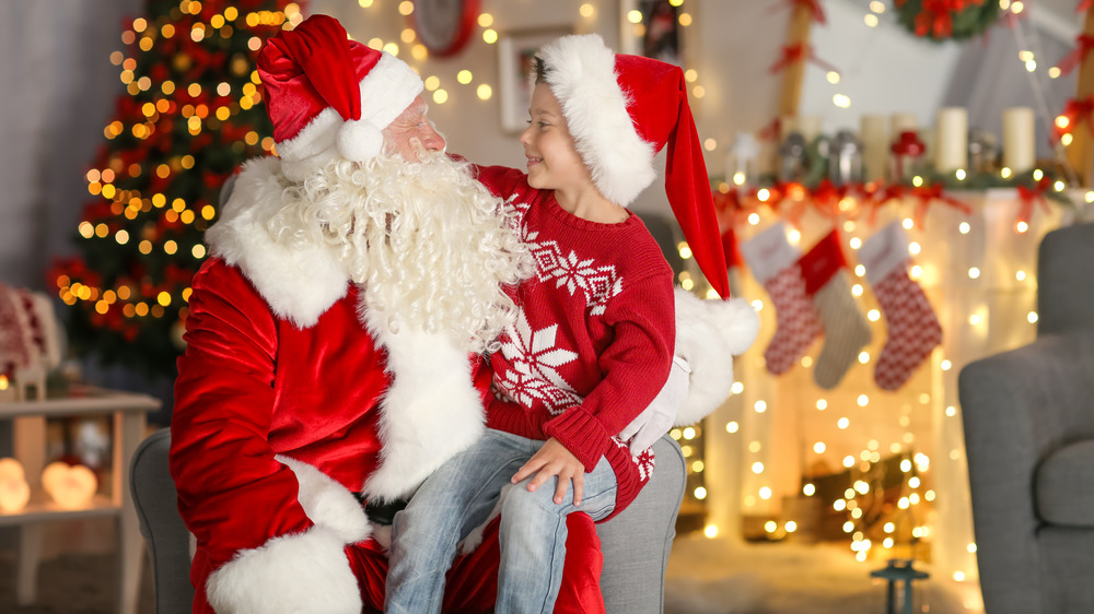Little boy sitting on Santa's lap