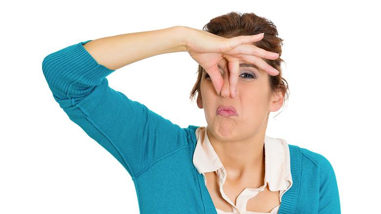 woman making gross face