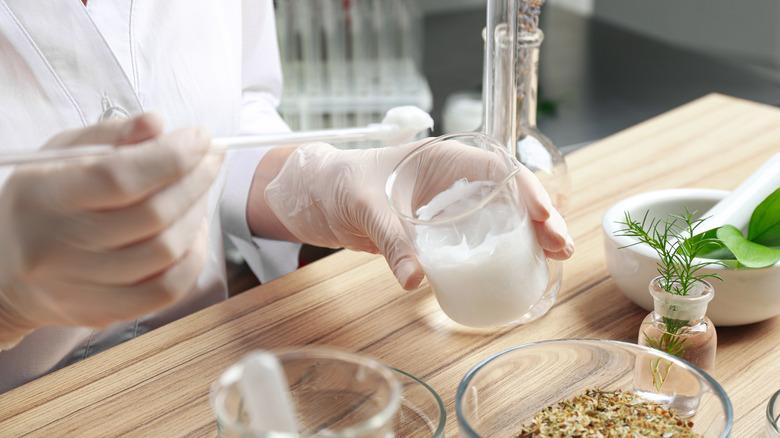scientist creating material in lab