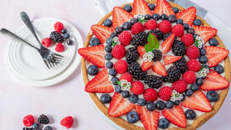 fruit pizza brimming with strawberries, blueberries, red raspberries and blackberries