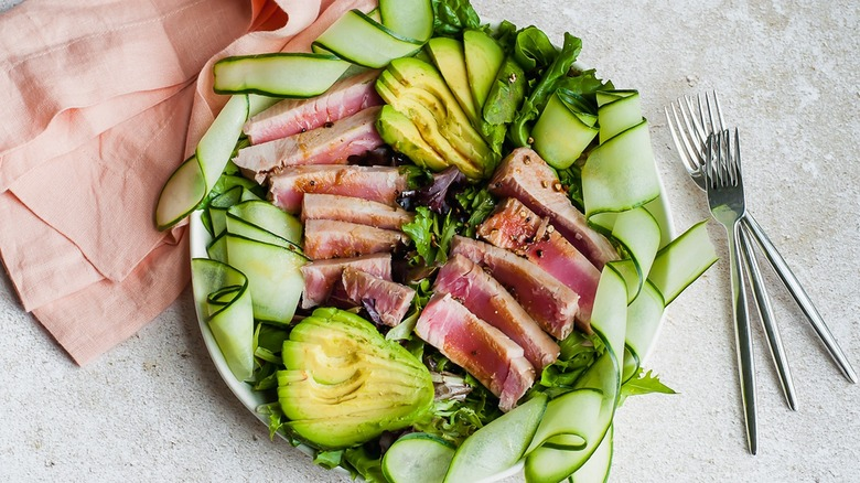 tuna salad plate with avocado and cucumber ribbons