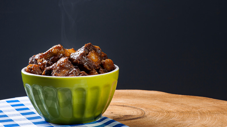 Cooked oxtail in a bowl