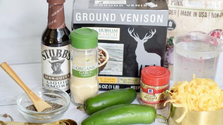 ground venison, liquid smoke, garlic powder, curing salt, cheddar cheese, and jalapenos