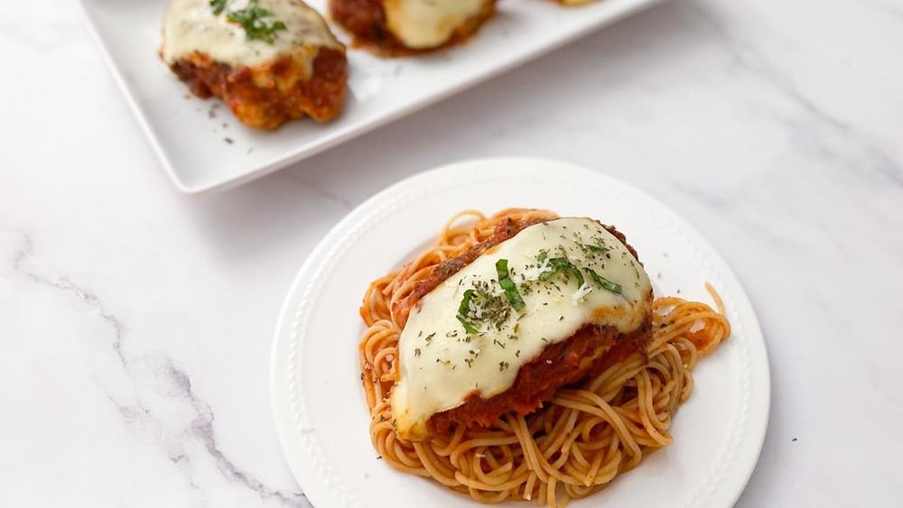 chicken Parmesan on a bed of spaghetti noodles