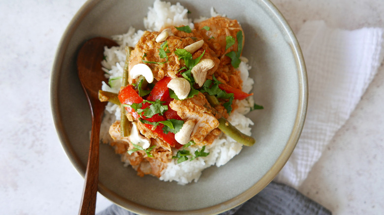 Coconut Curry Cashew Chicken on rice in bowl