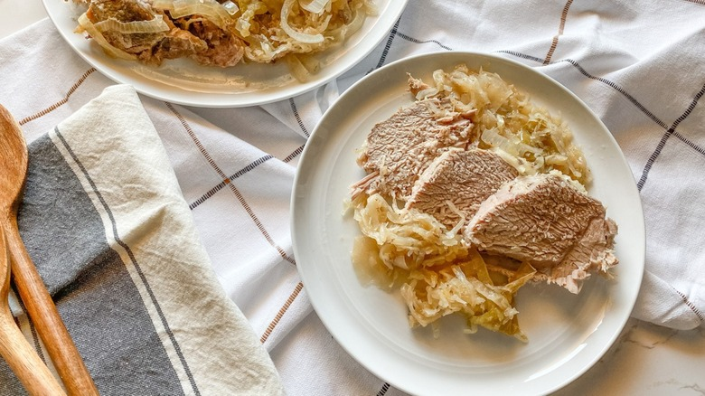 Slow Cooker Pork And Sauerkraut With Apples on plates