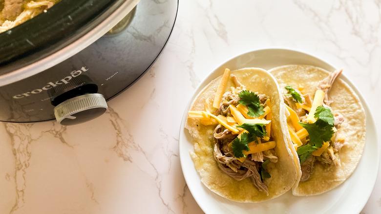 Slow cooker pork green chili servd in tortillas