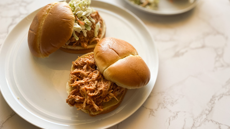 Slow Cooker Pulled Chicken served on sandwiches