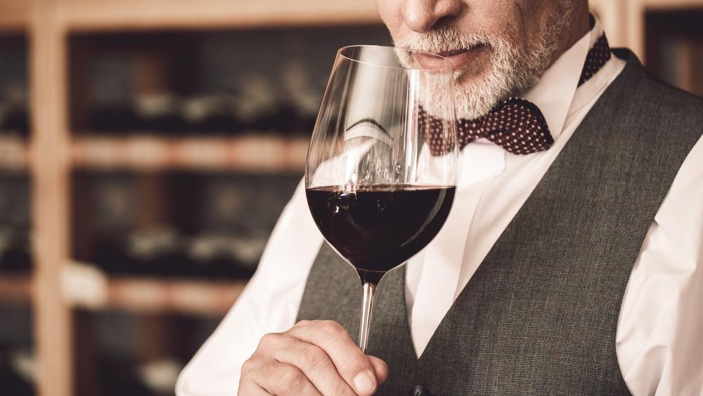 Distinguished sommelier evaluating wine