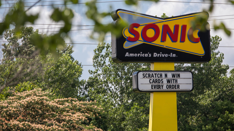 Sonic drive-in sign behind leaves