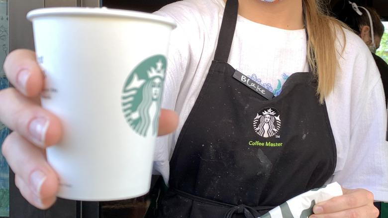 Starbucks employee makes order