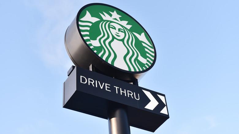 Starbucks sign against blue sky