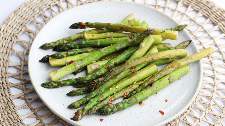 cooked asparagus spears on plate