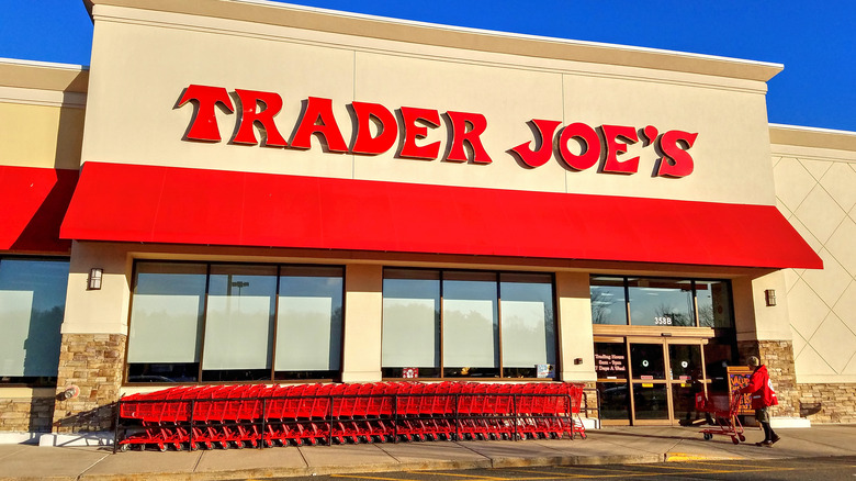 Trader Joe's storefront with row of red carts